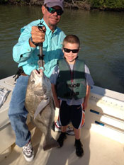 Black Drum caught by father and young son aboard Fins n Grins charter fishing boat on Marco Island