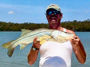 Charter Fishing Marco Island Boat Captain Michael Van Jones hooking yet another one off the shores of Marco Island